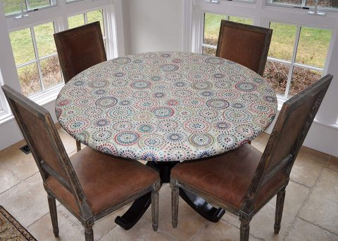 "Covers For The Home Elastic Edged Flannel Backed Vinyl Fitted Table Cover - Multi-Color Geometric Pattern - Large Round - Fits Tables up to 45″ - 56"" Diameter"